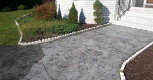 Before Concrete Cleaning in Chesapeake, VA by SoftWash Pros